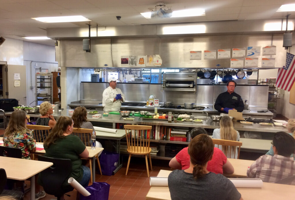 Mike Flynn, left,  director of student nutrition services RSU 12 and Patrick Britten, Sysco of Maine corporate chef, during the training for 80 regional school nutrition staff on Aug. 15 at Mt. Blue High School in Farmington.