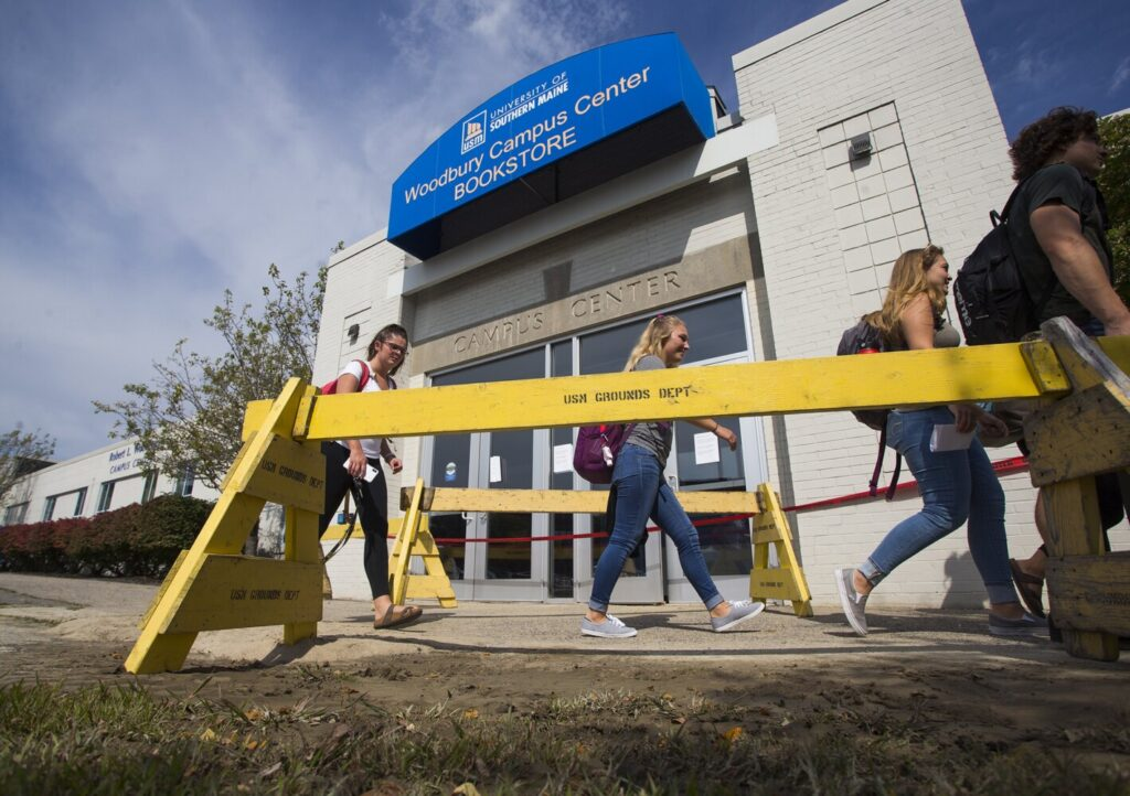 Students walk past Woodbury Campus Center, the hub of the University of Southern Maine's Portland campus, which will be closed for at least two weeks while crews work to repair the damage caused by a fire main break.
