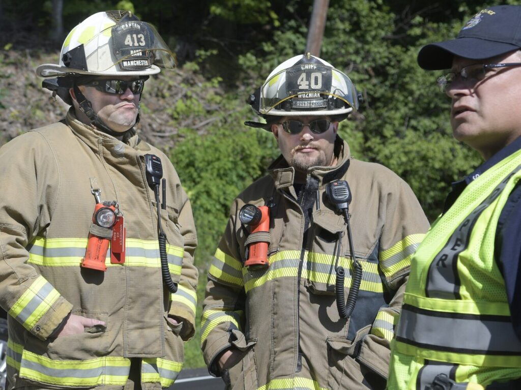 Manchester Fire Chief Frank Wozniak, center, at an accident Aug. 6, 2019, on Route 201 in Hallowell.
