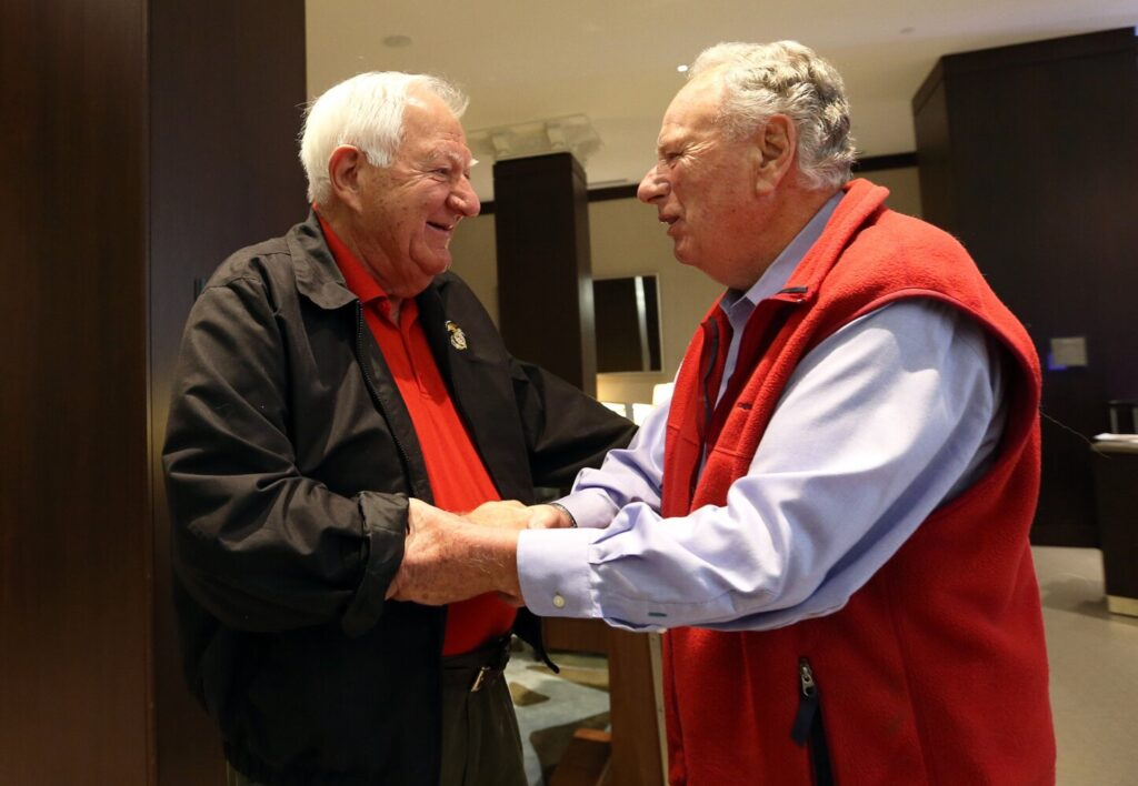 PORTLAND, ME - SEPTEMBER 28: Vietnam veterans, Orson Swindle, left, who was shot down during a bombing mission, shakes hands with Dick Manning, who was a forward spotter on the same mission, as they meet for the first time Saturday at the Westin Portland Harborview. (Staff photo by Ben McCanna/Staff Photographer)
