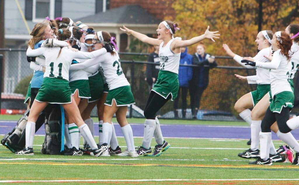 The Winthrop field hockey team celebrates its 3-1 victory over Spruce Mountain in the Class state final last year at Deering High School in Portland.