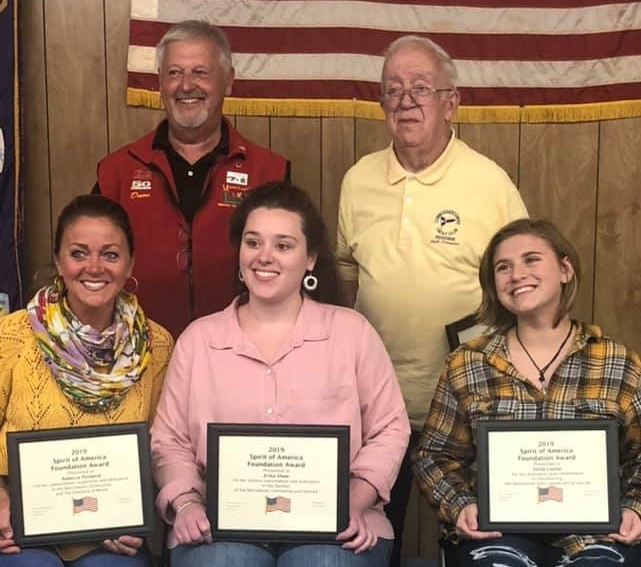 Front from left are  Spirit of America Foundation Award recipients Rebecca Pushard, Erika Shaw and Stella Lauter. Back from left are Dave Worthing, chairman of the Manchester Spirit of America; and award recipient Jack Schrader.