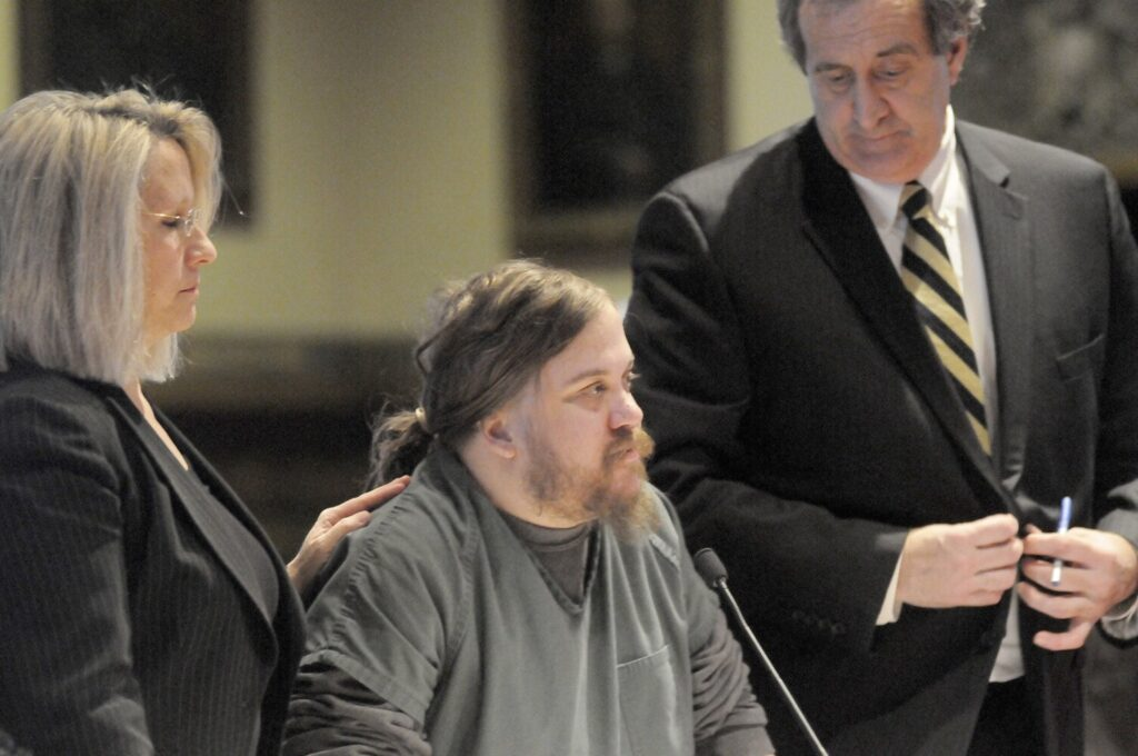 Eric Bard is flanked by his attorneys, Gina Yamartino and Ronald Bourget, during a hearing Jan. 5, 2015 at Kennebec County Superior Court in Augusta.