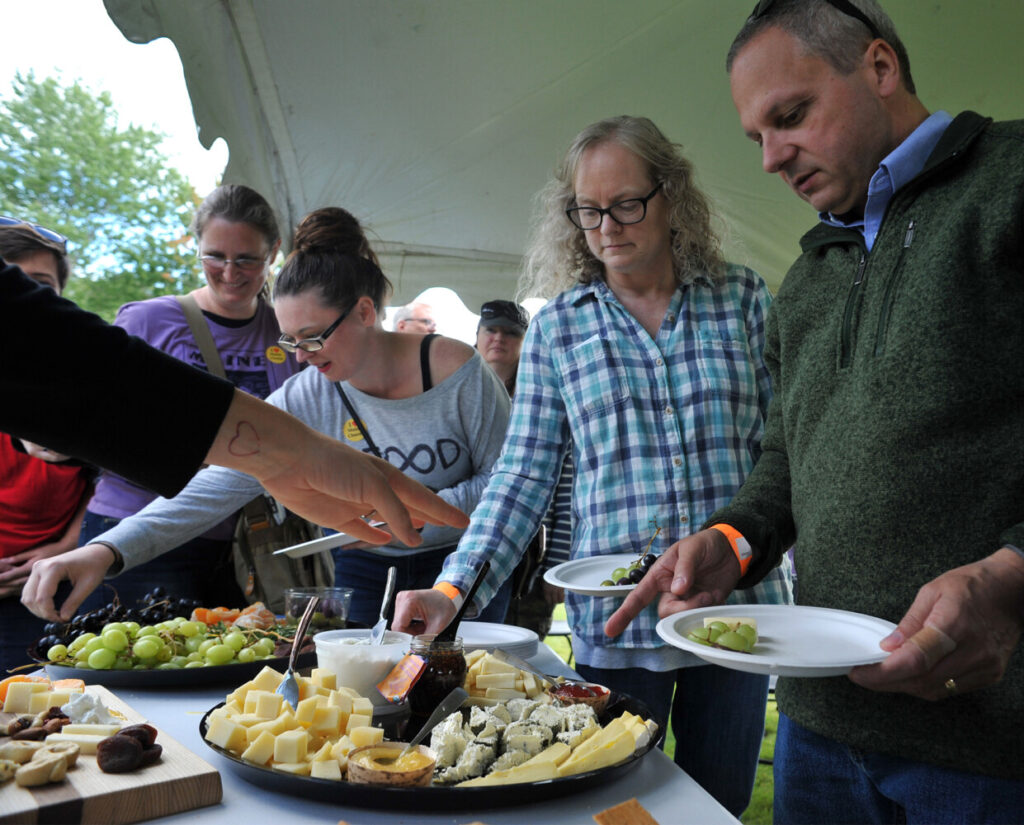 Ken and Pam Danforth, right of Hampden, Maine join others in sampling a cheese plate during a demonstration at 4th Annual Maine Cheese Festival in Pittsfield Maine Sunday September 8, 2019. The plate featured five different cheeses, dried and fresh fruits, nuts and a variety of crackers.