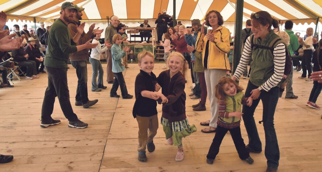 Ephraim and Shiloh Humes dance down between rows of square dancers in the fiddlers hall during the Common Ground Country Fair in Unity on Sept. 21, 2018. The 2019 edition of the fair opens Friday and runs through Sunday.