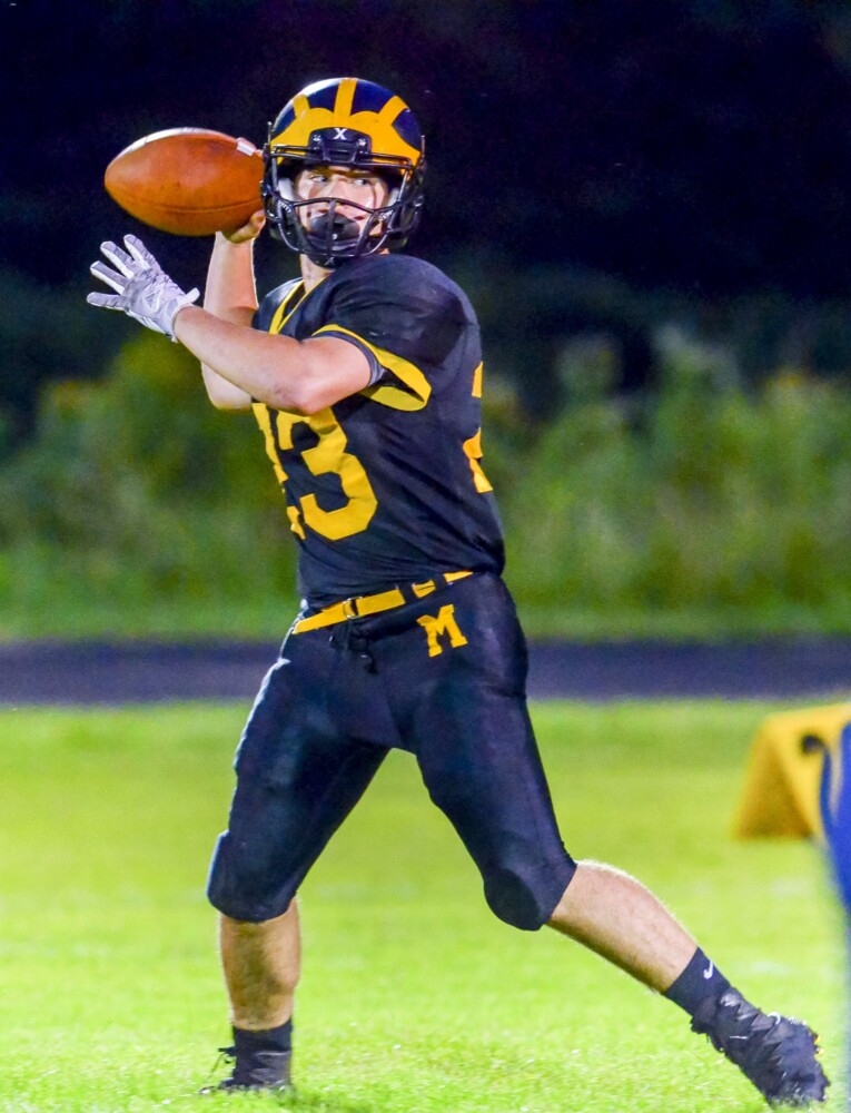 Maranacook quarterback Garit Laliberte drops back to pass during a game against Boothbay earlier this season at the Ricky Gibson Field of Dreams in Readfield.
