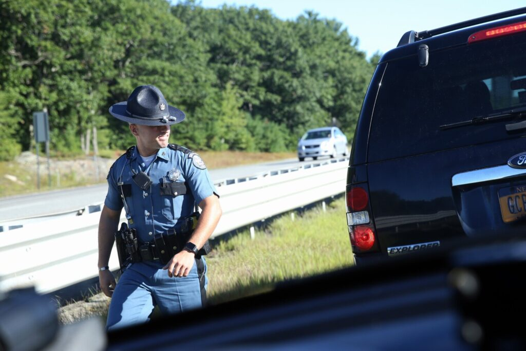 PORTLAND, ME - SEPTEMBER 5: Maine State Trooper Pat Flanagan returns to his unmarked cruiser after stropping a New York driver for speeding and viewing her cellphone while driving on Interstate 95 on Thursday. (Staff photo by Ben McCanna/Staff Photographer)