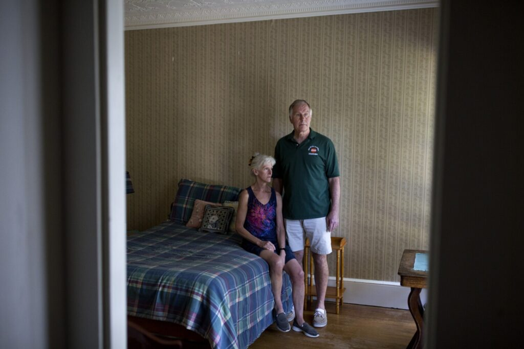 Sally McLaren and Ben Gumm sit in the now bare-bones bedroom of their son, Alex, at their home on Sept. 3.