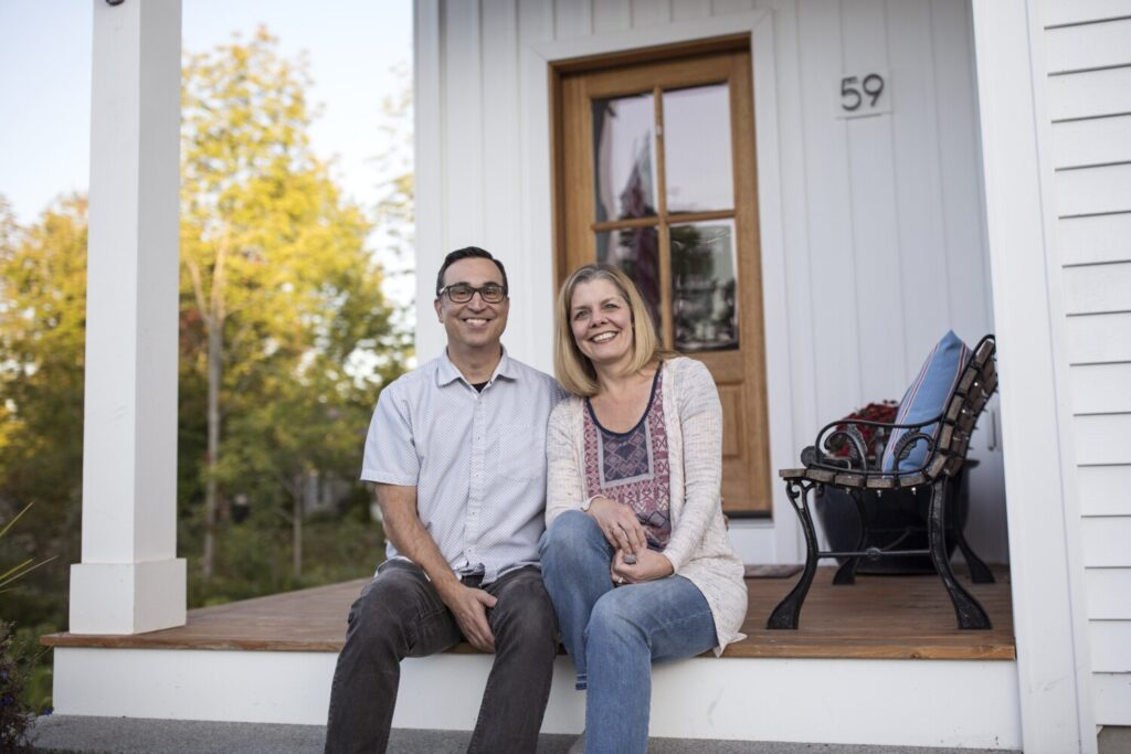 Rob and Wendy Pereira sit outside their home in Portland. The couple moved to Portland from the San Francisco Bay Area nearly two years ago. The Greater-Portland area is different than most U.S. metro areas in that more than half of the buyer interest in its available homes is coming from outside of the state.