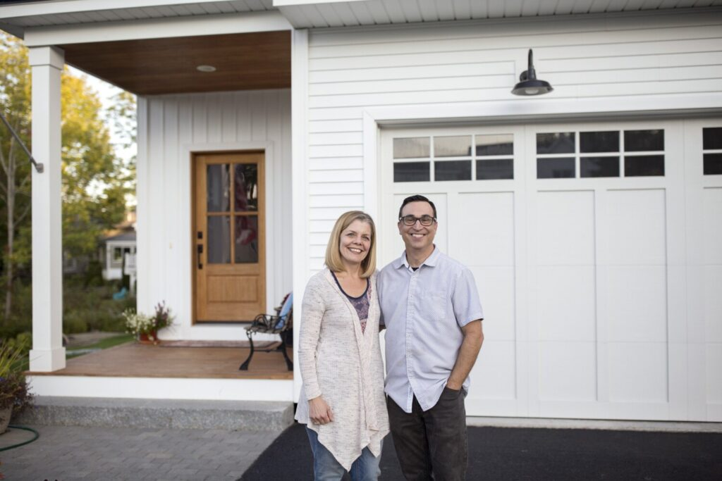 PORTLAND, ME - SEPTEMBER 18: Rob and Wendy Pereira outside their home in Portland on Wednesday, Sept. 18, 2019. The couple moved to Portland from the San Francisco Bay Area nearly two years ago. The Greater-Portland area is different than most U.S. metro areas in that more than half of the buyer interest in its available homes is coming from outside of the state. (Staff Photo by Brianna Soukup/Staff Photographer)