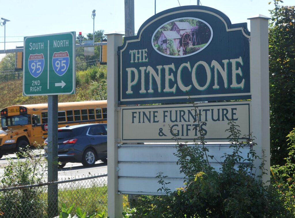 The Waterville Planning Board on Monday will consider rezoning part of 475 Kennedy Memorial Drive to allow an adult-use-marijuana store to open there once state rule regarding adult-use marijuana are issued. The former Pine Cone furniture shop at that address is seen near the Interstate 95 interchange on Thursday.