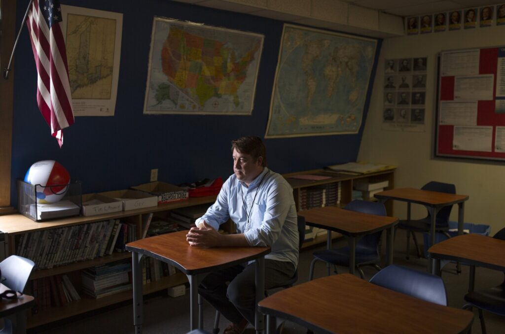 History teacher Chad Denis in his classroom at Old Orchard Beach High School on Tuesday. Denis' first day of student teaching was 18 years ago, Sept. 11, 2001.
