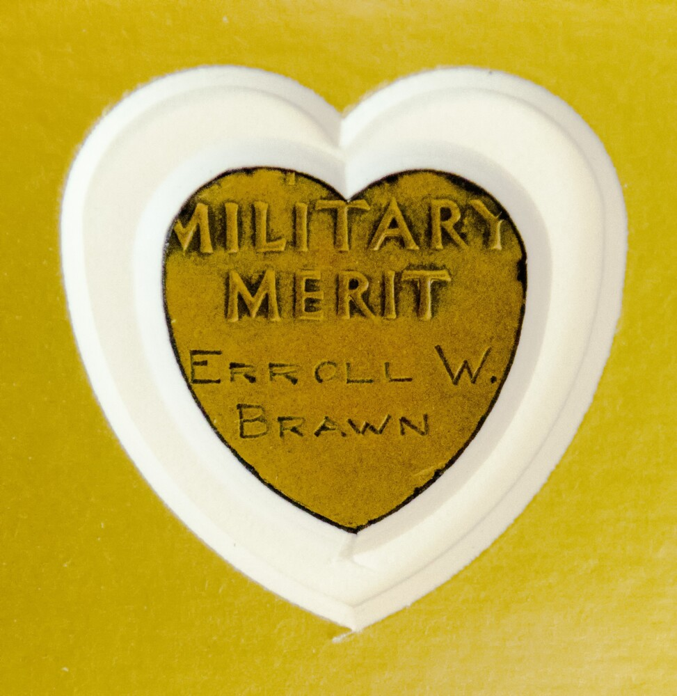 Purple Hearts Reunited presented the medal of Sgt. Erroll Wilbert Brawn to the Maine Army National Guard on Thursday at Camp Chamberlain in Augusta. The frame has a cutout on back so that the inscription is visible.