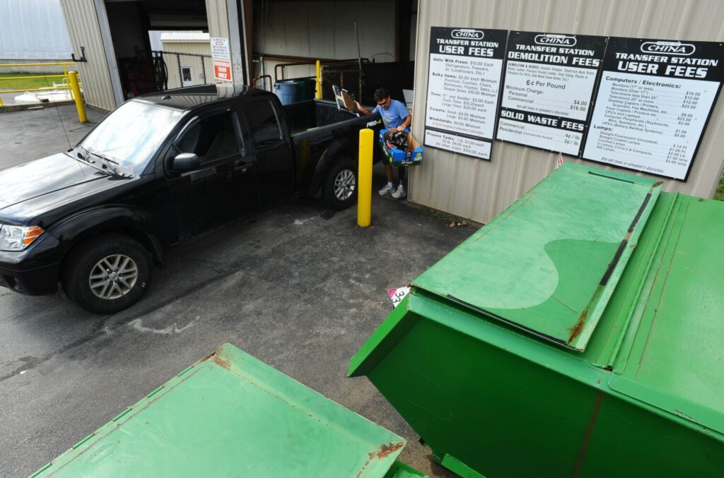 Trash is dropped off at the hopper at the China Transfer Station on Wednesday.