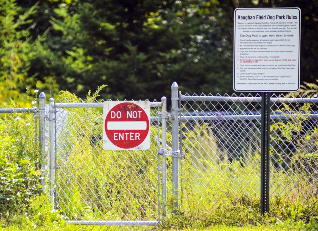 There is a recently installed padlock and Do Not Enter sign on the gate of the closed Hallowell dog park, seen Sept. 11 at Vaughan Field in Hallowell.