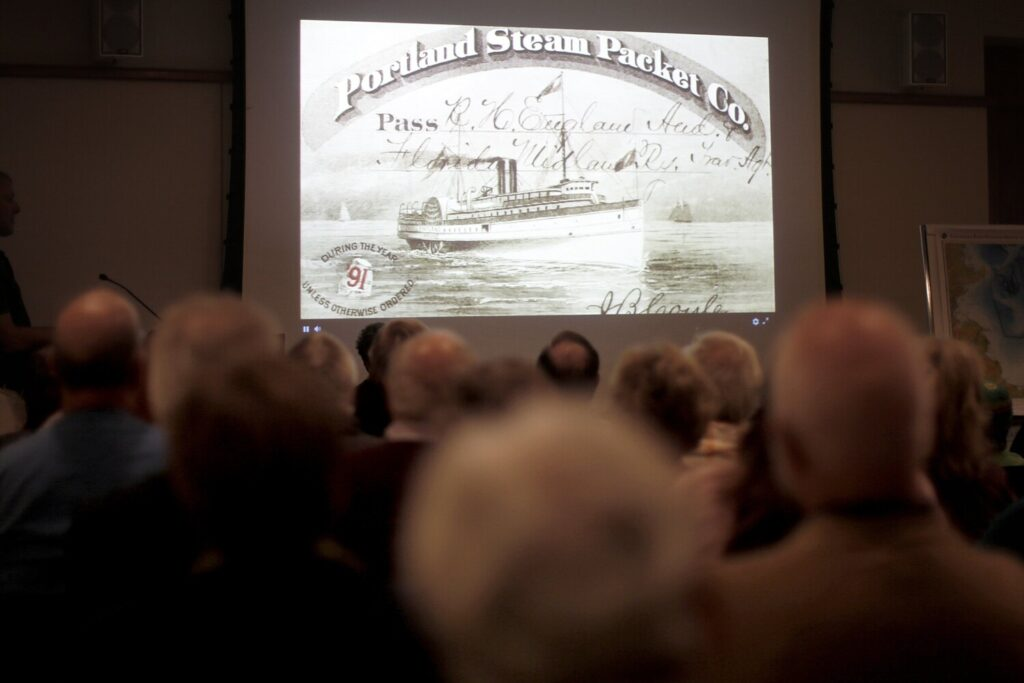 Descendants of people who died when the SS Portland sank are in the audience at the Maine Historical Society on Wednesday to watch researchers explore the wreck off the coast of Massachusetts using a remotely operated submersible.