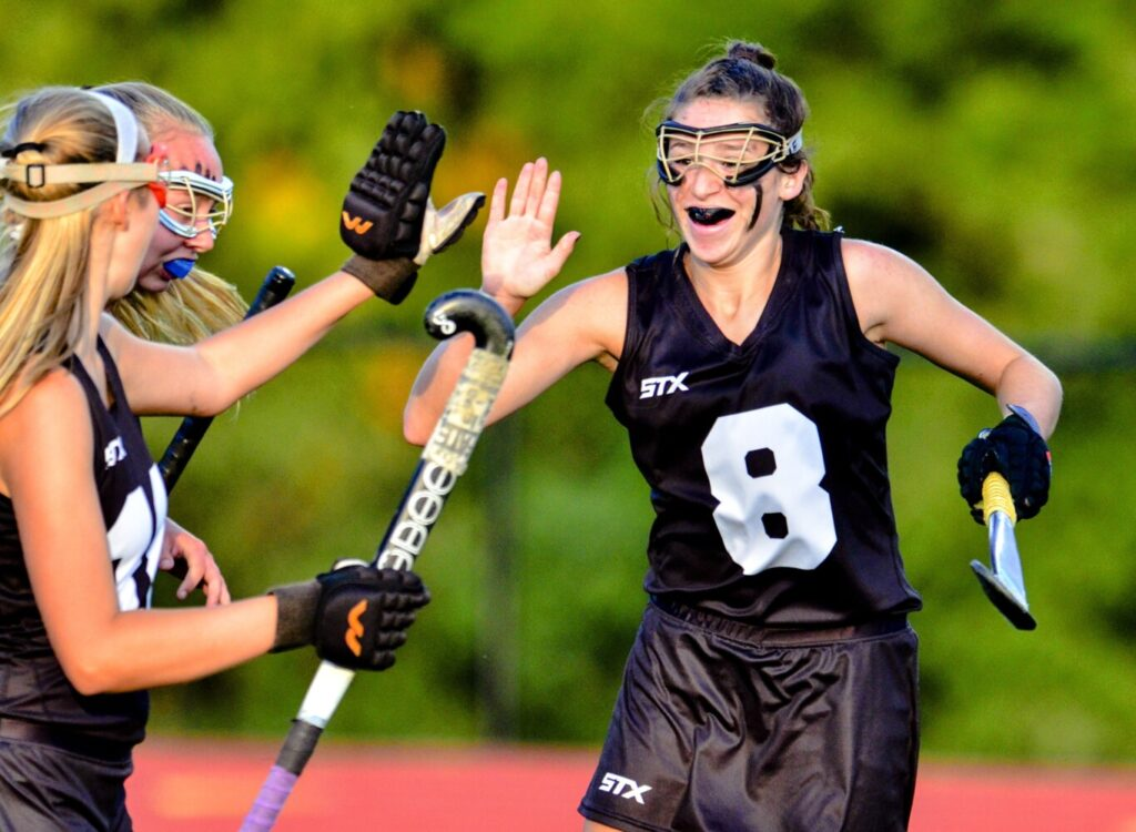 Skowhegan's Bhreagh Kennedy celebrates after scoring on a penalty stroke against Messalonskee during a game this fall in Oakland.