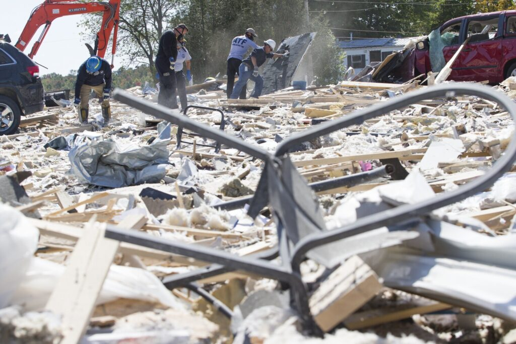 The blast leveled the building that housed LEAP - a nonprofit that serves people with cognitive and intellectual disabilities- damaged or destroyed more than a dozen homes and blanketed the surrounding area with shredded paper, insulation and lumber.