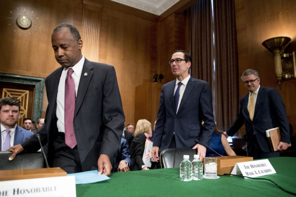 """From left, Housing and Urban Development Secretary Ben Carson, Treasury Secretary Steve Mnuchin, and Federal Housing Finance Agency Director Mark Calabria appear before a Senate Banking Committee hearing on Capitol Hill on Tuesday. Mnuchin said last week that the administration is """"committed to promoting much needed reforms to the housing finance system that will protect taxpayers and help Americans who want to buy a home."""""""