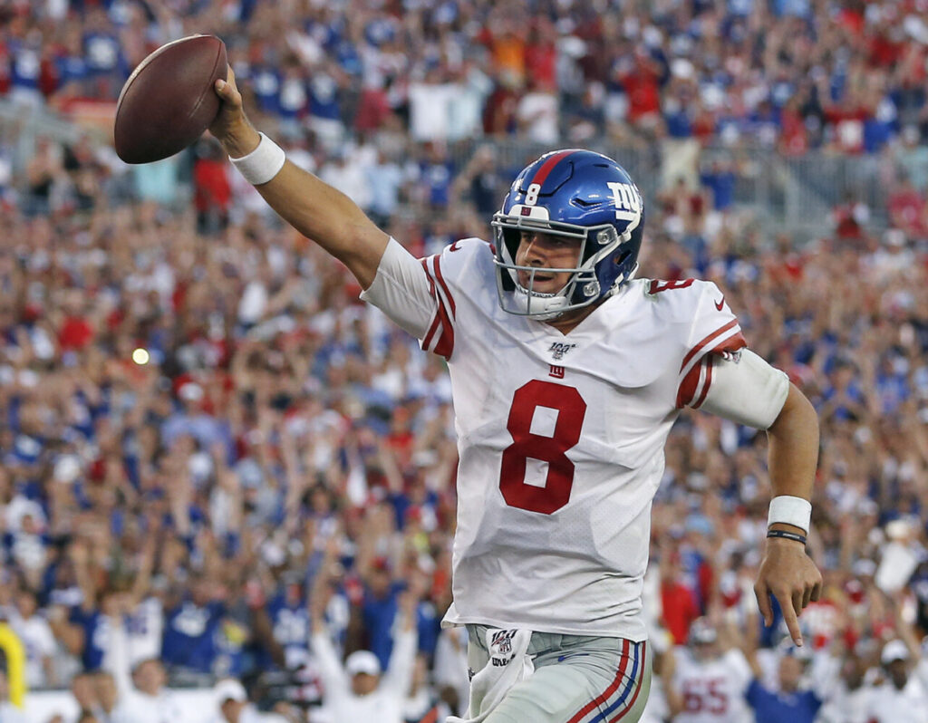 New York Giants quarterback Daniel Jones runs seven yards for a second-half touchdown Sunday against the Buccaneers in Tampa, Florida.