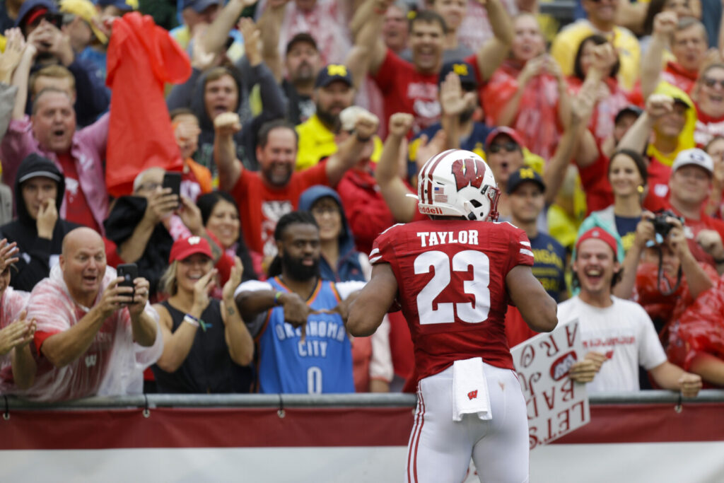 Jonathan Taylor rushed for 203 yards and two touchdowns to lead Wisconsin to a 35-14 win over Michigan on Saturday in Madison, Wisconsin.