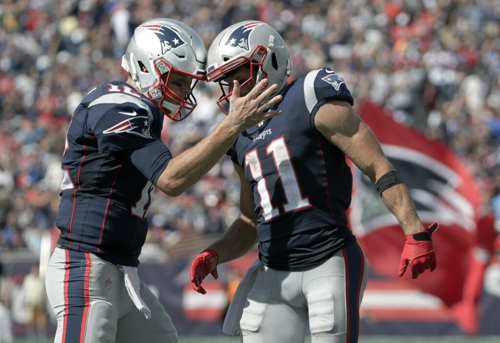 New England Patriots quarterback Tom Brady, left, celebrates with Julian Edelman after they hooked up for a touchdown pass in the Patriots' 30-14 win over the New York Jets on Sunday in Foxborough, Mass.