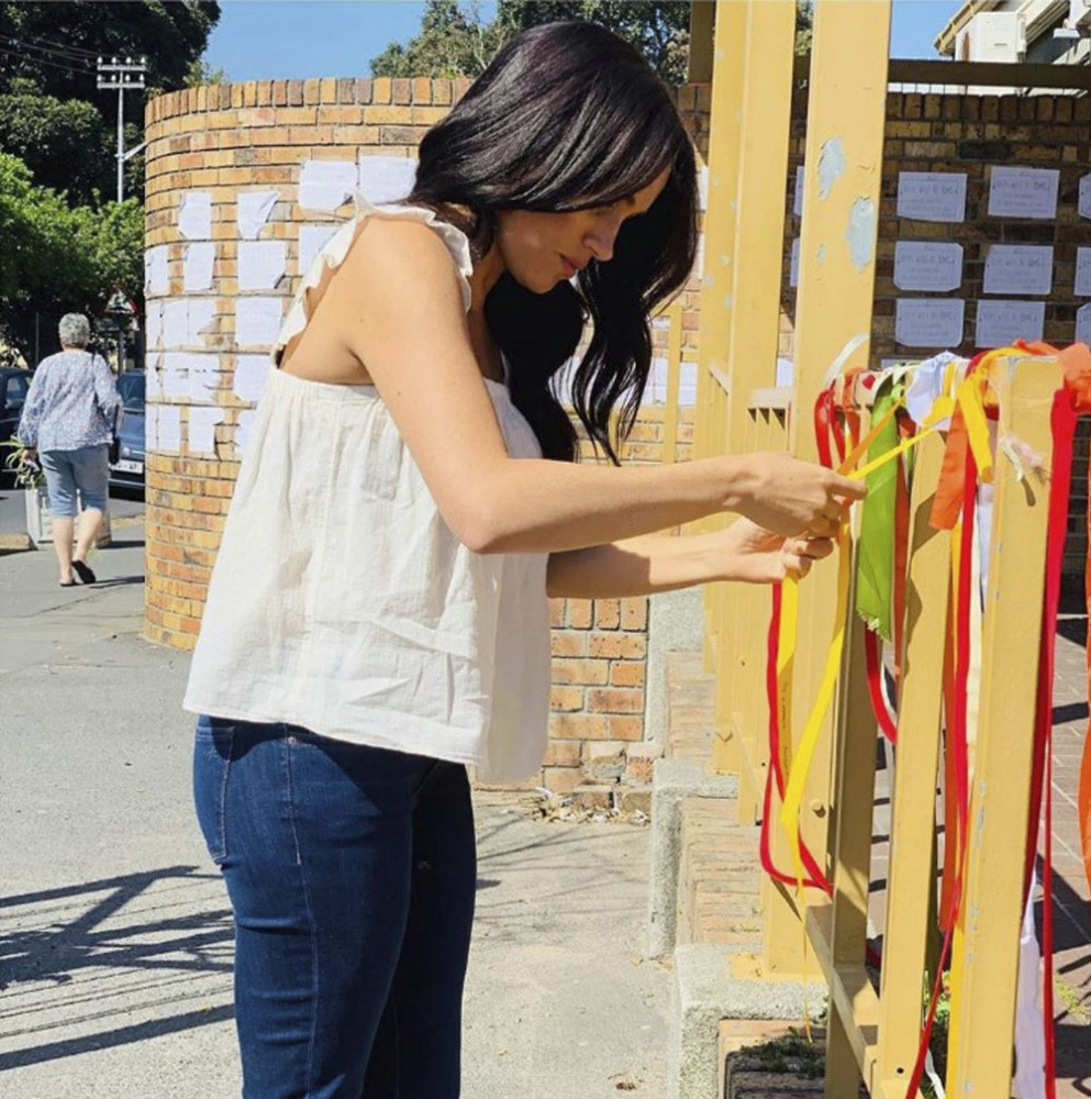 "Britain's Meghan, the duchess of Sussex, visits the memorial to a murdered South African student as a ""personal gesture"" after ""closely following the tragic story."""