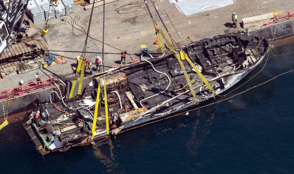 The burned hull of the dive boat Conception is brought to the surface by a salvage team off Santa Cruz Island, Calif.
