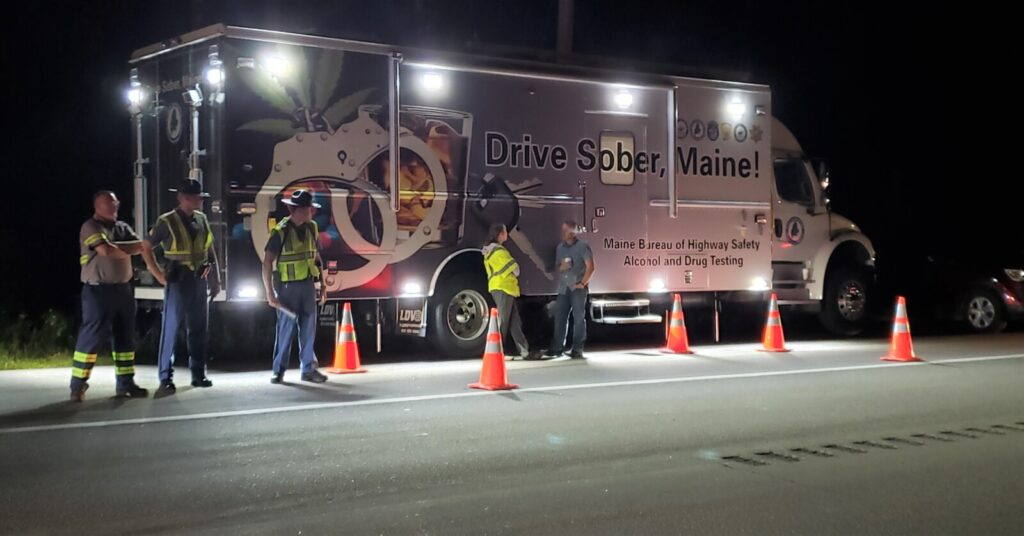 Officers work at a sobriety checkpoint last week on Route 202 in Lebanon.