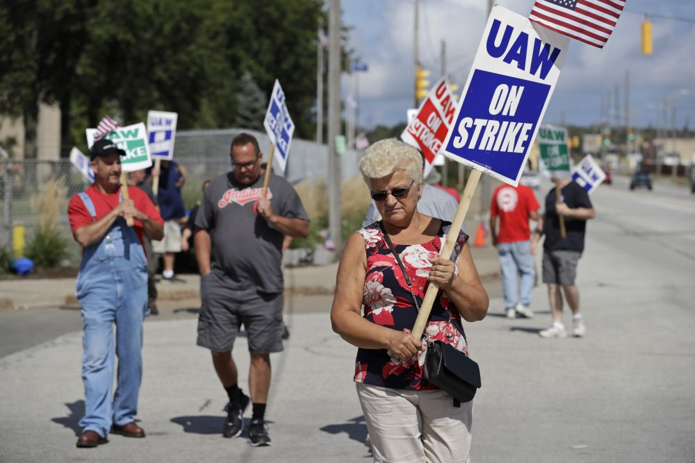 Mara Paulic, a 42-year GM employee, pickets outside the General Motors Fabrication Division in Parma, Ohio.