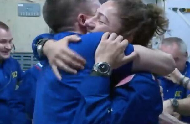 Maine astronaut Jessica Meir gets a big hug after arriving on board the International Space Station on Wednesday.