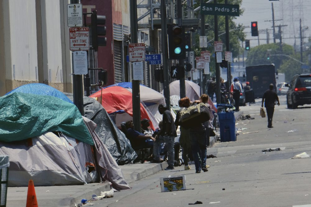 Tents housing the homeless line a street in downtown Los Angeles in May. The Trump administration is still actively exploring options for a crackdown on homelessness aimed at California, a process that has been ongoing for months.