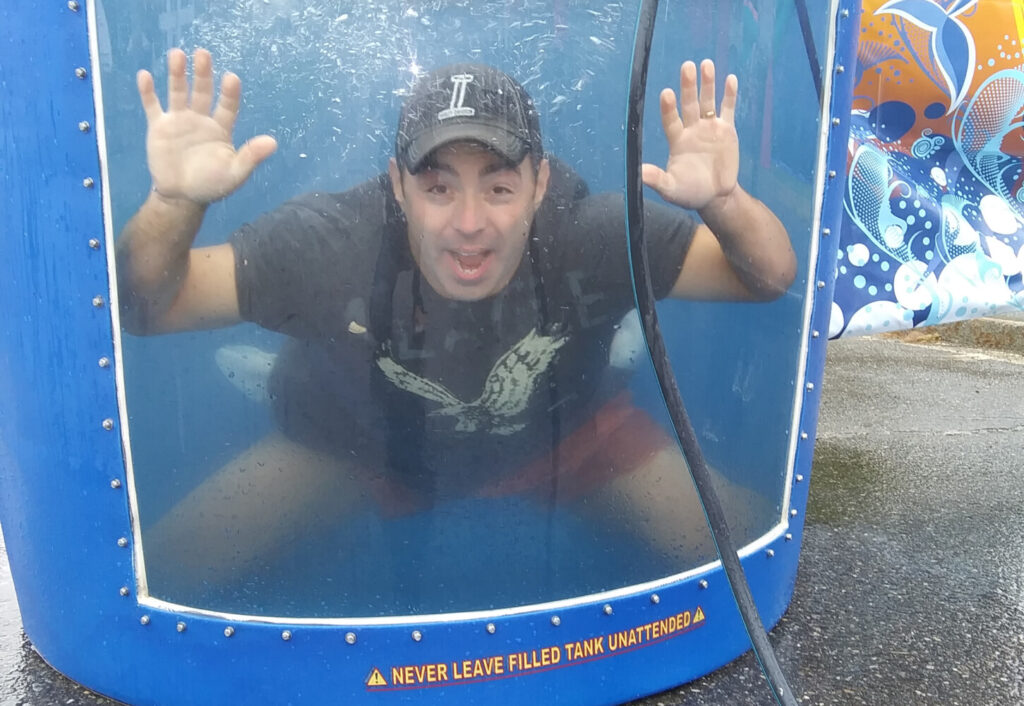 Carrabec Community School Principal Michael Tracy in the dunk tank during the school's Second annual Back to School Bash in North Anson.