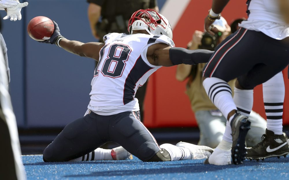 New England's Matthew Slater celebrates his touchdown after recovering a blocked punt against the Buffalo Bills on Sept. 29. According to reports, Slater signed a two-year extension with the Patriots.