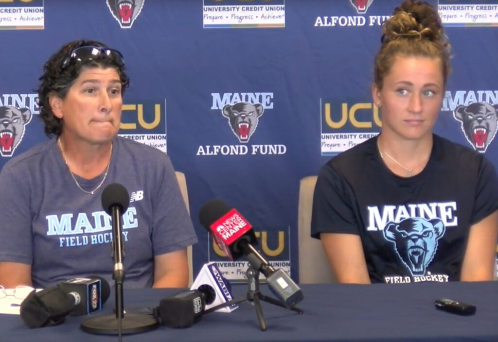 University of Maine field hockey Coach Josette Babineau, left, and senior Riley Field discuss the team's aborted game at Kent State during a media conference in Orono on Monday.