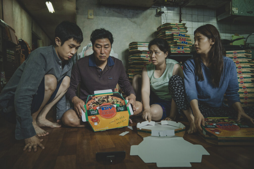"The Kim family, from left, Choi Woo Shik, Song Kang Ho, Chang Hye Jin and Park So Dam in ""Parasite."""