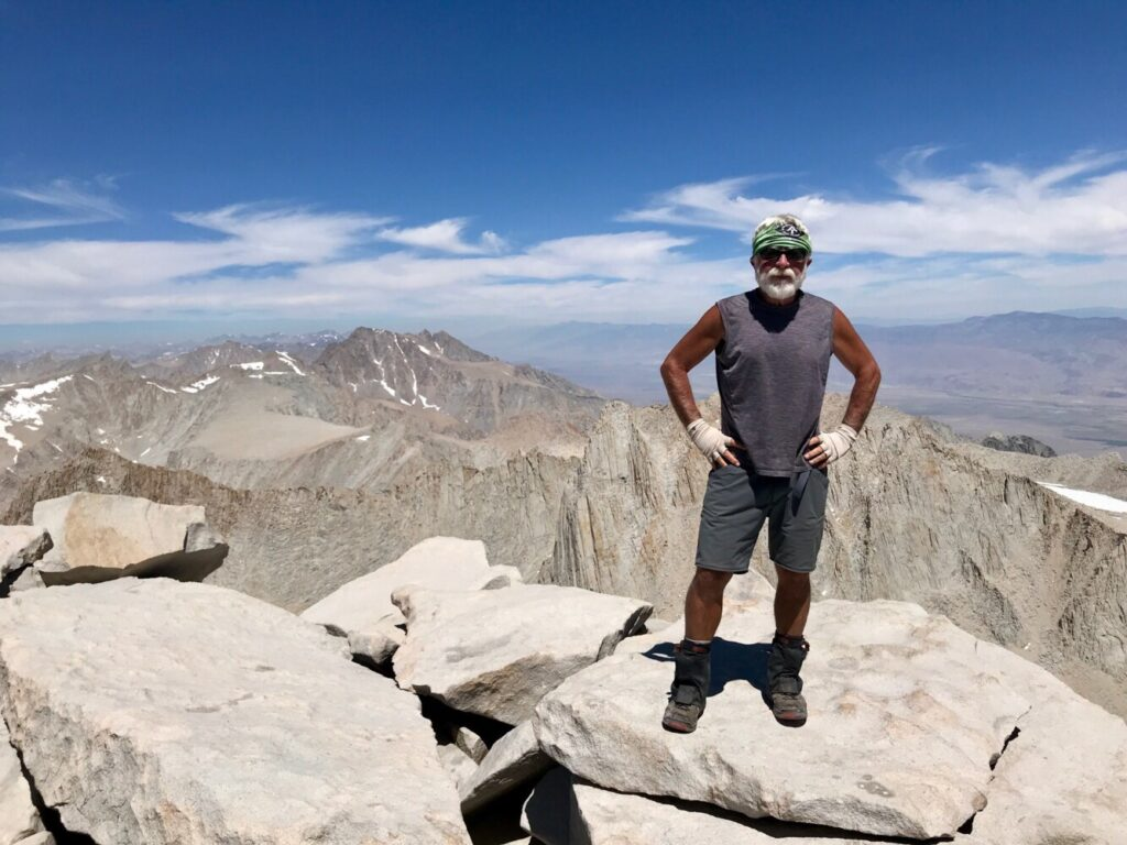 Carey Kish stands triumphantly atop 14,505-foot Mt. Whitney, the crown jewel of the High Sierra and the highest peak in the contiguous U.S.