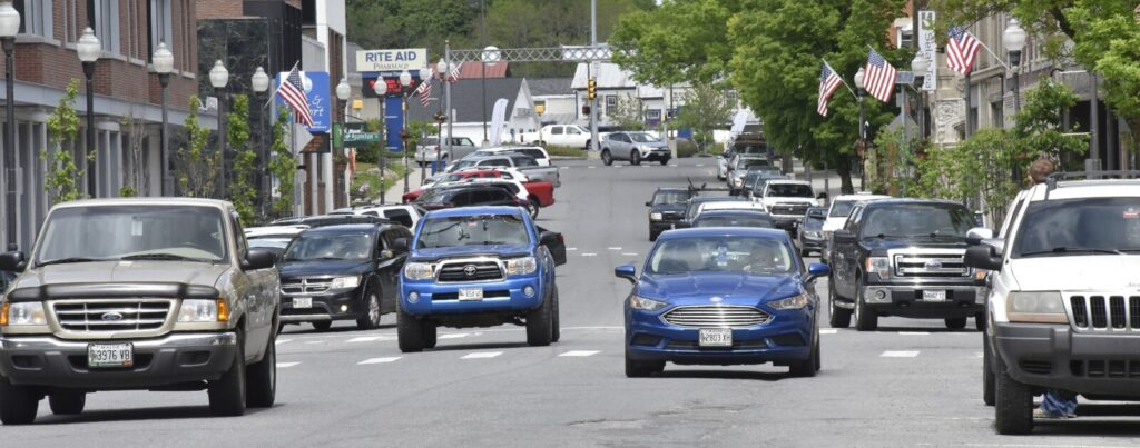 One-way traffic moves through downtown Waterville on Main Street on June 5. There will be a meeting Tuesday for the public to see designs for turning Main and Front streets from one-way to two-way, among other changes.