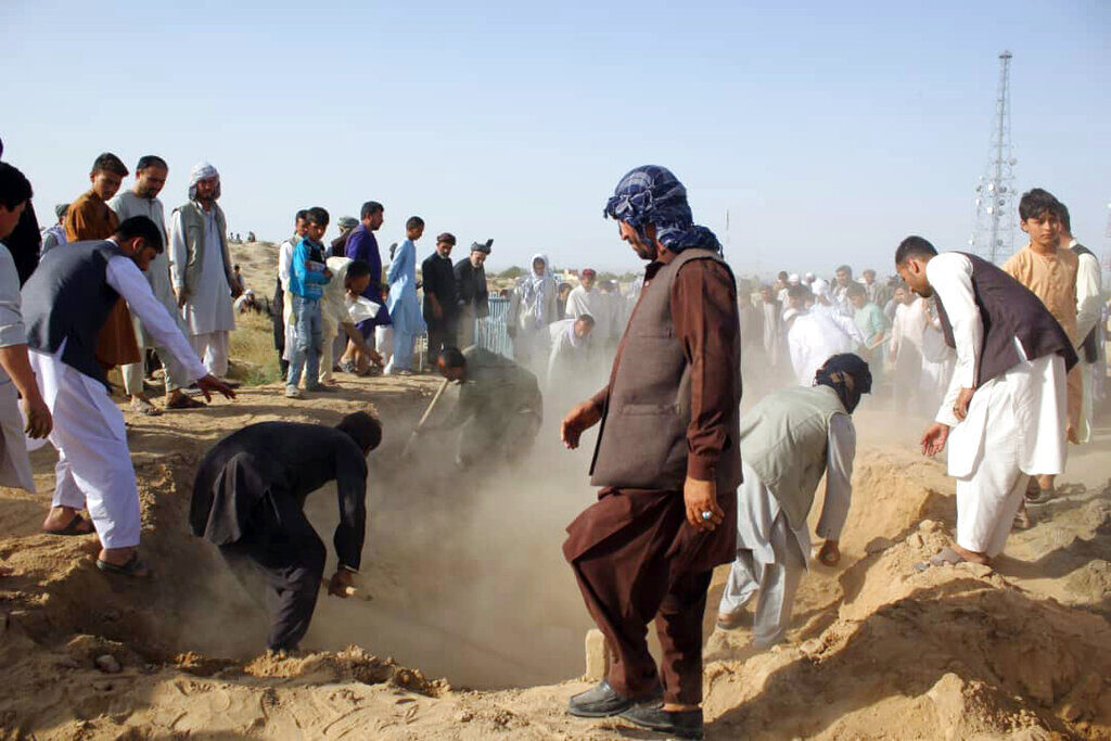 Afghan men bury security personnel killed in a suicide attack on Saturday in Kunduz province, north of Kabul on Sunday. The Taliban attacked a second Afghan city in as many days on Sunday and killed several members of security forces, officials said.