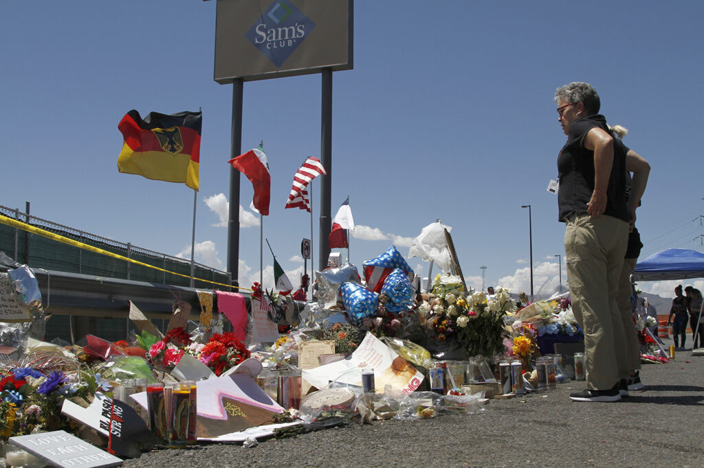 Mourners visit the makeshift memorial near the Walmart in El Paso in August. Walmart wrote its own letter urging for a debate over reauthorizing an assault weapons ban.