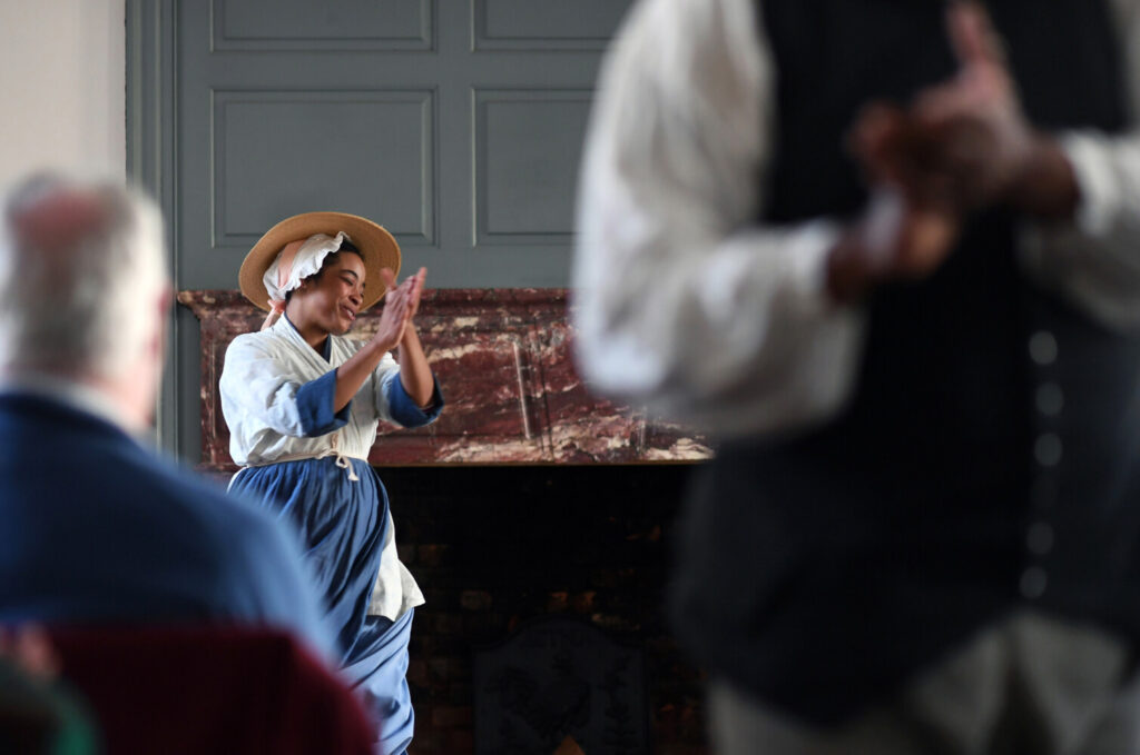 """Katrinah Carol Lewis takes part in a performance of """"Joy in the Morning"""" at Colonial Williamsburg in February 2019 in Williamsburg, Va. The program illustrates the life of slaves in colonial times."""