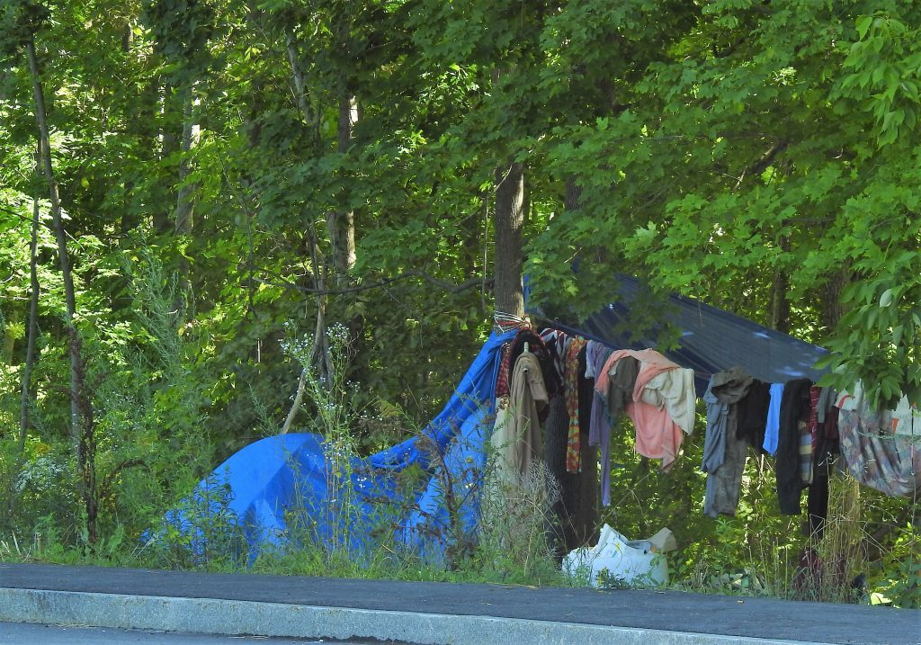 People have been dropping off items at the homeless encampment in Sanford's mill district, which is causing problems, officials say.