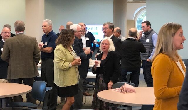 Members of Saco-Biddeford's business community mingle before the inaugural Saco-Biddeford Business Breakfast Forum. Dozens turned out at the People's Choice Credit Union community meeting room to hear experts discuss the area's hot commercial real estate market.