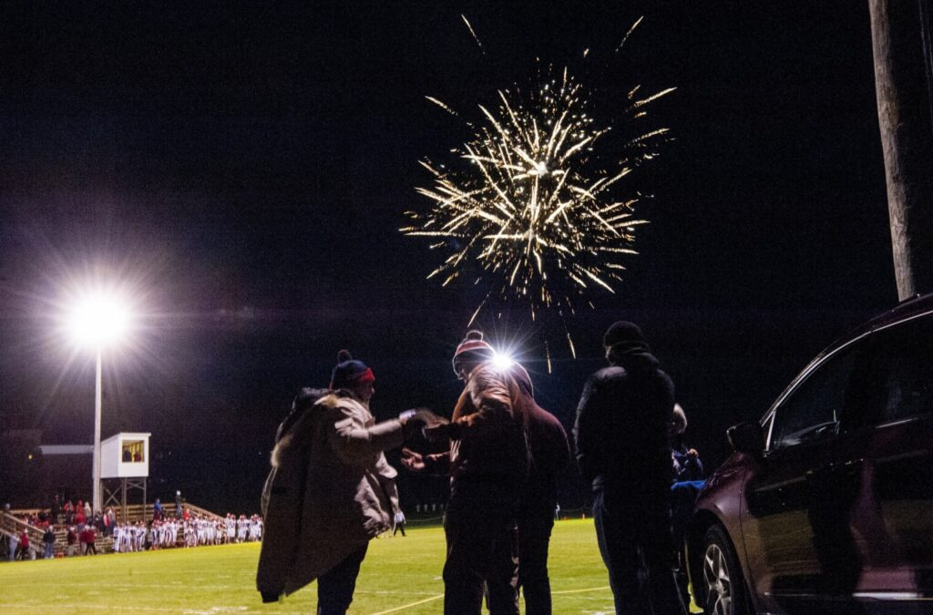 Fireworks light up the sky before a game between Wells and Maine Central Institute in Pittsfield last Friday night.