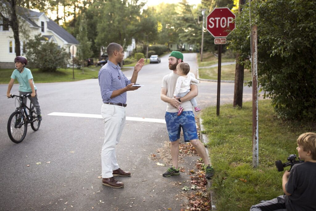 "Portland mayoral candidate Spencer Thibodeau chats with John Osterman while canvassing in the Rosemont neighborhood last month. Thibodeau, who grew up in the neighborhood, says he would be an ""honest broker"" as mayor."