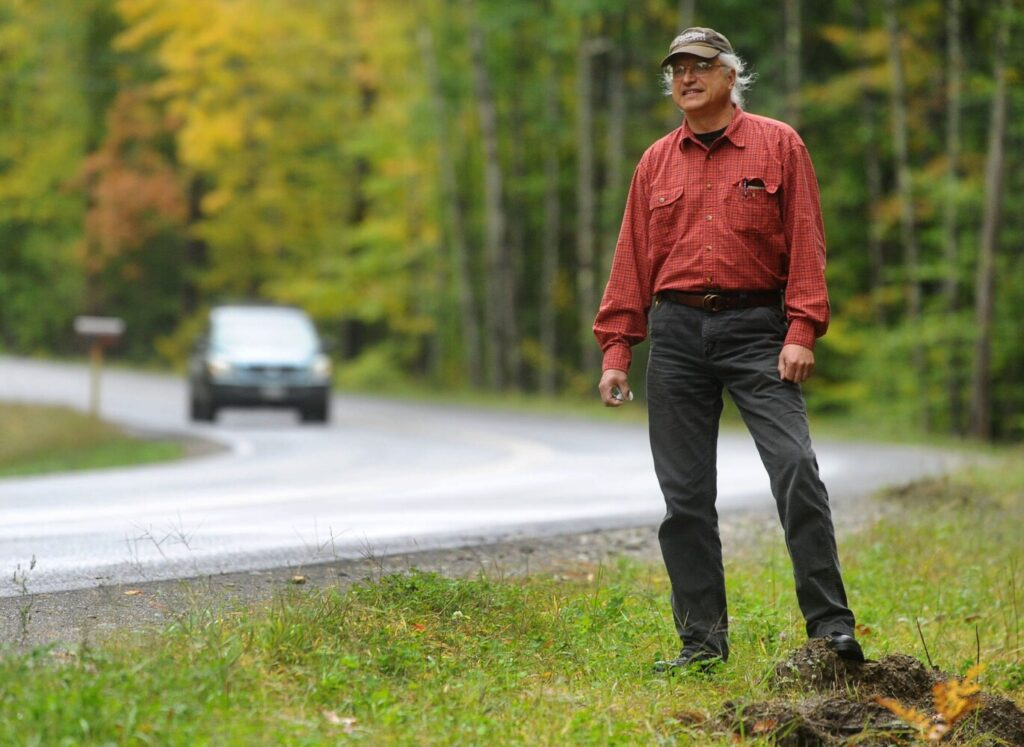 Tom Streznewski of Belgrade stands Oct. 2 near the section of Route 225 in Rome where his truck slid off the road in September and was destroyed.