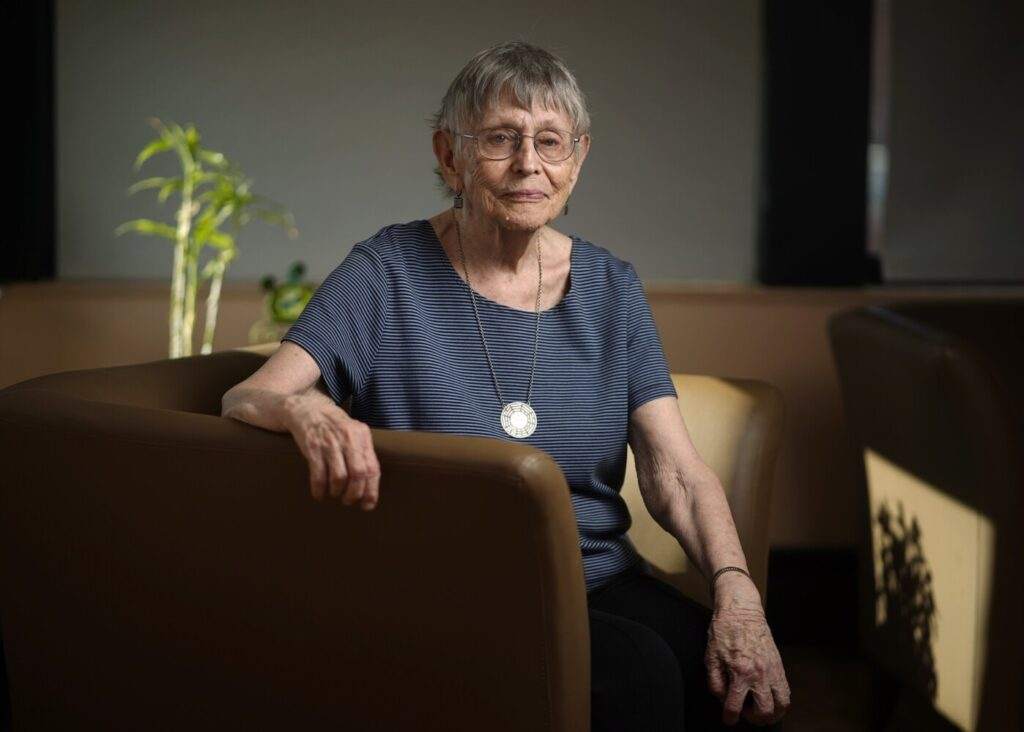 "Jacqueline Moore, 92, sits for a portrait Friday in her Portland apartment building. She has just published a book of poems titled ""Chasing the Grass"" that addresses issues brought on by climate change."