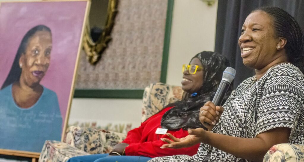 Tarana Burke, founder of Me Too and Girls for Gender Equity, right, speaks during a question-and-answer session Wednesday with Samaa Abdurraqib, from the Maine Center to End Domestic Violence, during the Maine Women's Summit on Economic Security at the Augusta Civic Center.