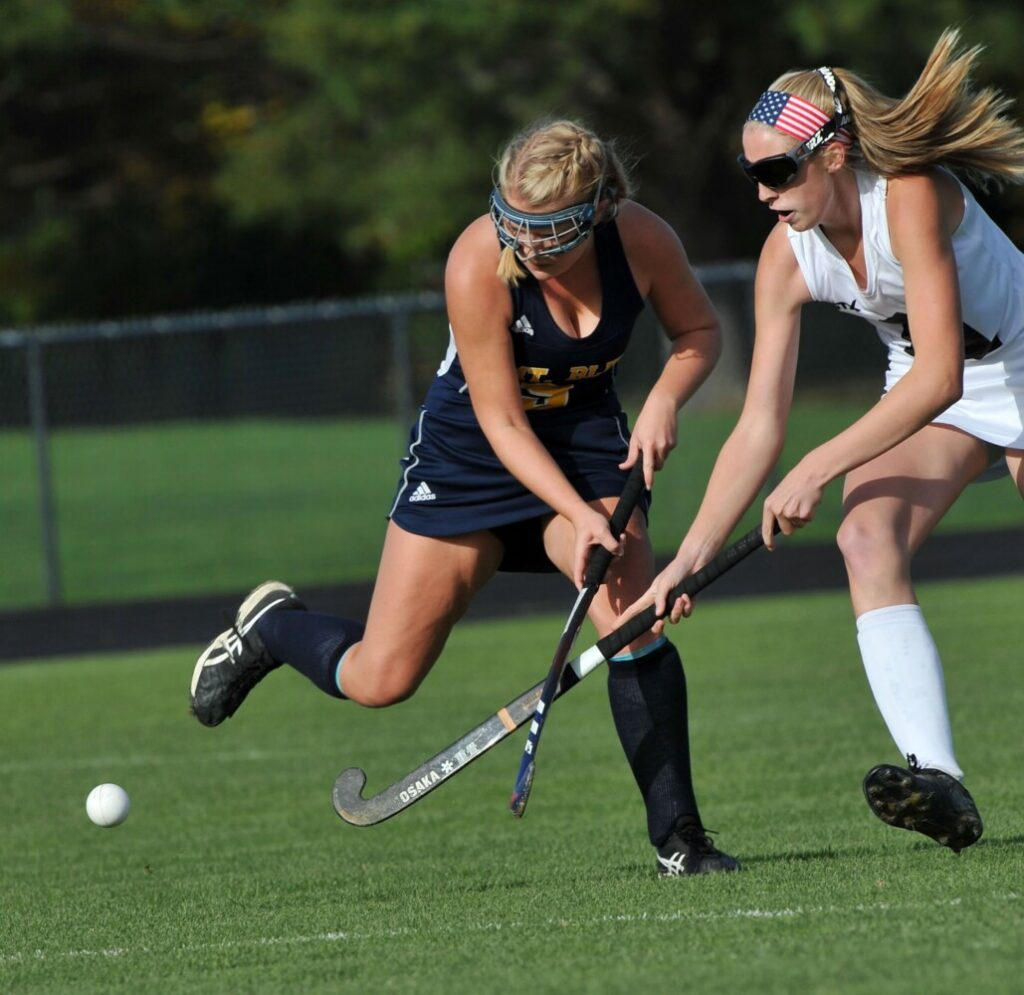 Skowhegan senior forward Emily Reichenbach, right, battles Mt. Blue's Bailey Levesque for possession of the ball during a Class A North field hockey game Tuesday in Skowhegan.