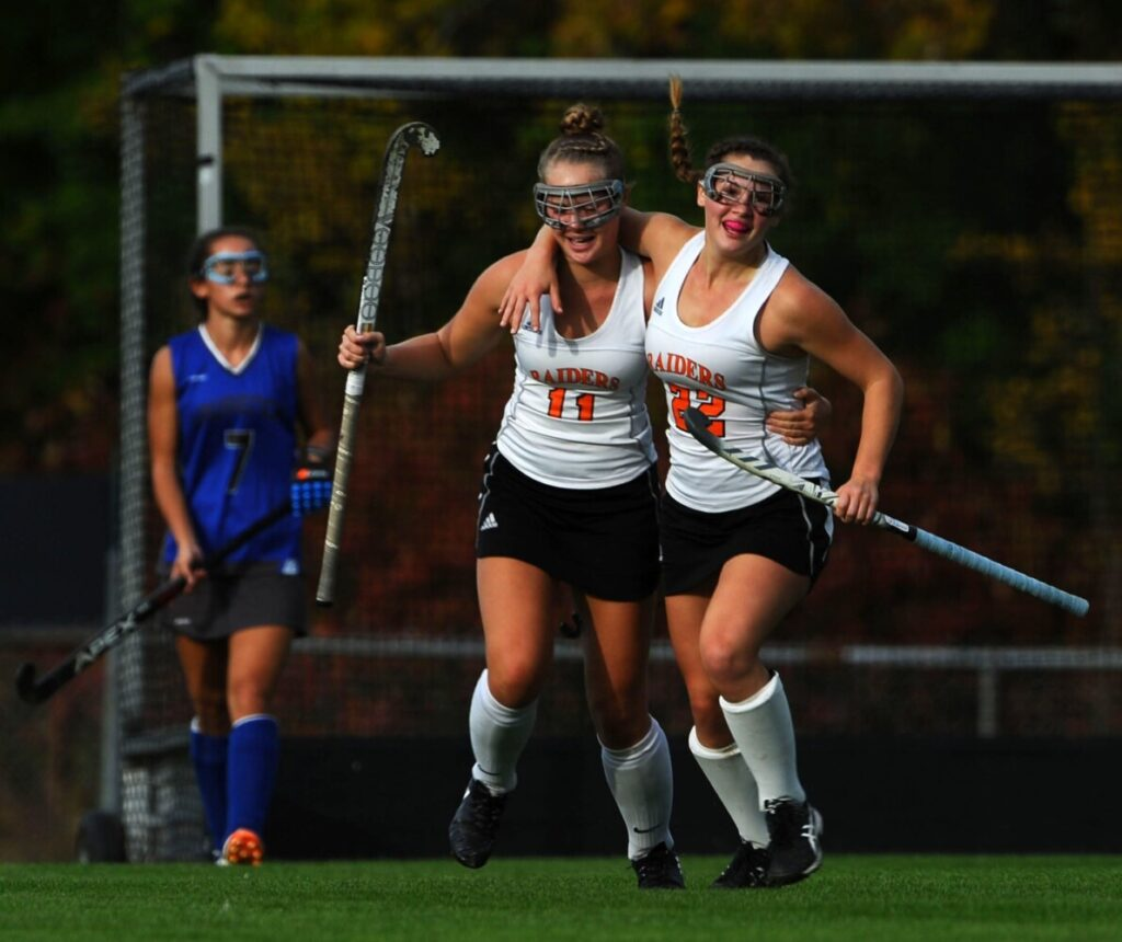 Winslow midfielder Bodhi Littlefield, right, celebrates her goal with teammate Silver Clukey during a game earlier this season in Winslow. The Black Raiders beat John Bapst in the Class B North quarterfinals on Tuesday.